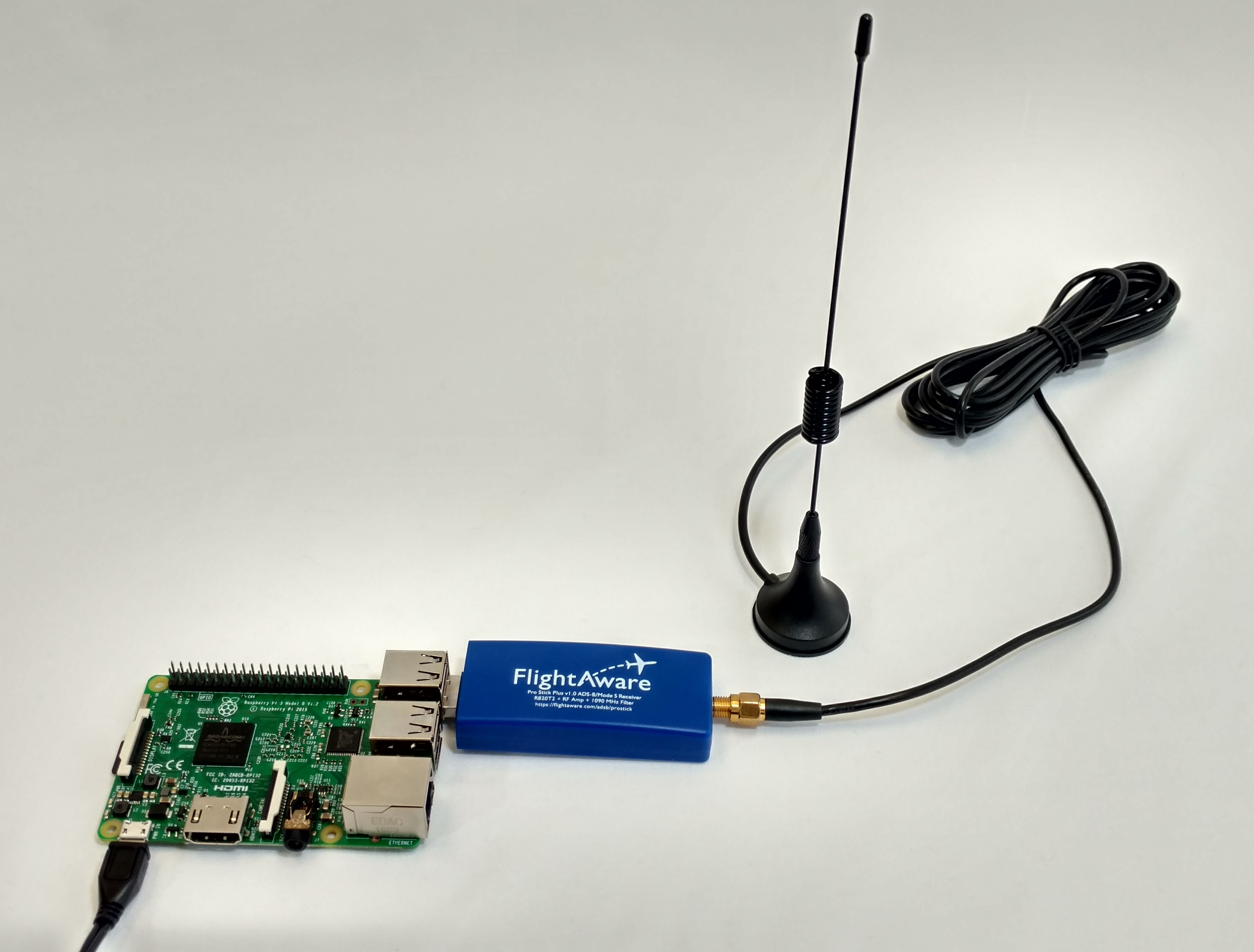 Raspberry Pi connected to power and an antenna